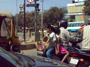 Two kids on the pillion seat